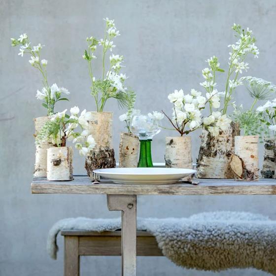 Duka med vaser av stubbar!